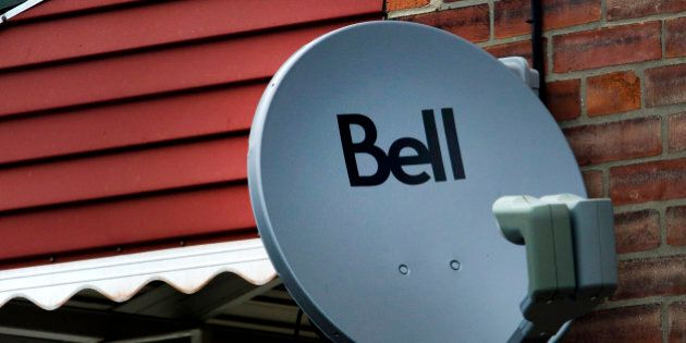 A Bell Canada television satellite is mounted outside of a home in Toronto, Ontario, Canada, on Thursday,...