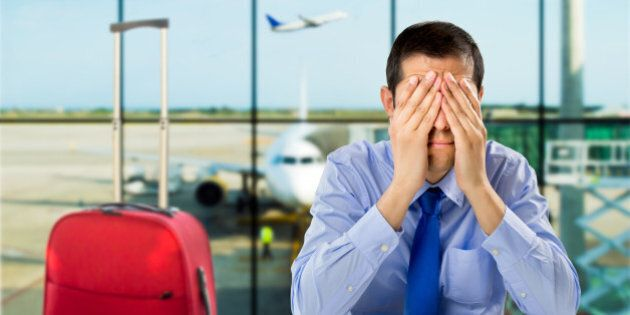 crying businessman who delayed flight at an