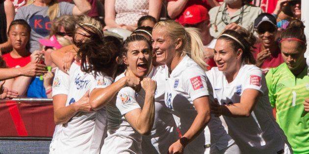 VANCOUVER, BC - JUNE 27: Claire Rafferty #3 of England celebrates team mate Lucy Bronze's #12 (not pictured)...