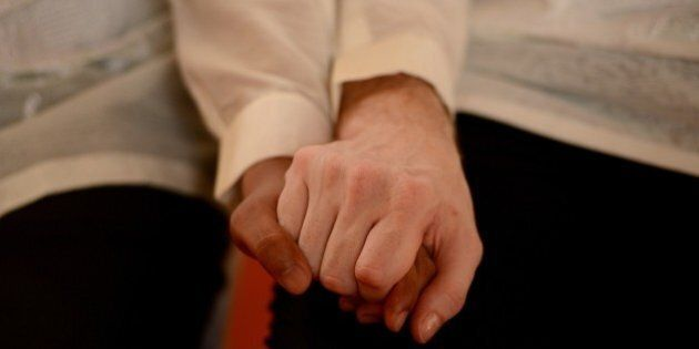 US Michael Ellis (R) and Filipino Jesus Bascal (L) hold hands during a 'Rite of Holy Union' ceremony...