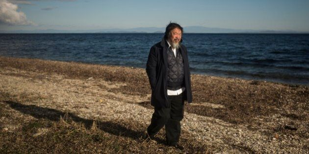 Chinese activist and artist Ai Weiwei walks on a beach next to the town of Mytilini, on the Greek island...