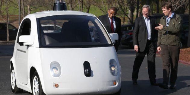 MOUNTAIN VIEW, CA - FEBRUARY 02: Google's Chris Urmson (R) shows a Google self-driving car to U.S. Transportation...