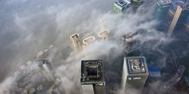 SHANGHAI, CHINA - DECEMBER 08: (CHINA OUT) Buildings at Lujiazui are shrouded in smog on December 8,...