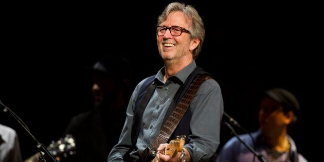 FILE - In this April 14, 2013 file photo, Eric Clapton performs at Eric Clapton's Crossroads Guitar Festival...