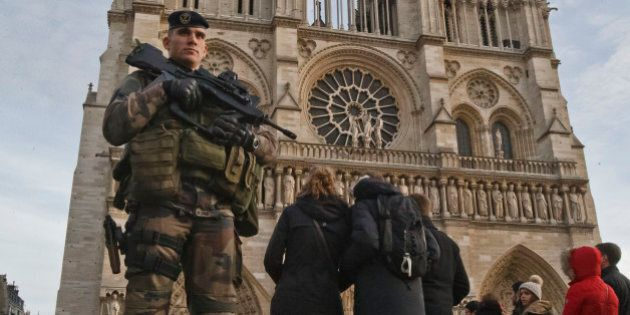 A soldier patrols at the Notre Dame cathedral in Paris, Wednesday, Dec. 30, 2015. France's defense minister...