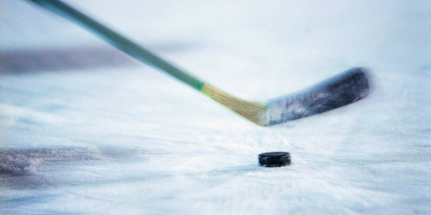 View of an ice hockey stick about to hit the