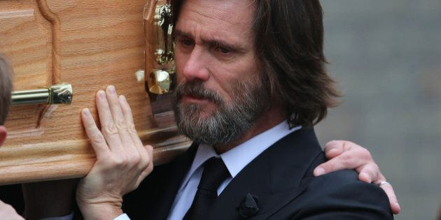Actor Jim Carrey, carries the coffin of his ex-girlfriend Cathriona White as they walk to Our Lady of...
