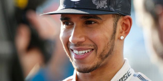 Mercedes driver Lewis Hamilton of Britain speaks during an interview after winning the Japanese Formula...
