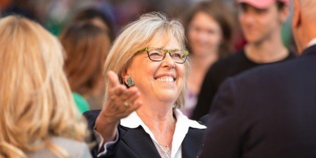 Green Party leader Elizabeth May greets dignitaries as she arrives for the first federal leaders debate on August 6, 2015 in Toronto, Canada. The federal election is set for October 19, 2015.AFP/ GEOFF ROBINS        (Photo credit should read GEOFF ROBINS/AFP/Getty Images)