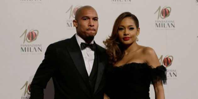AC Milan midfielder Nigel de Jong, of the Netherlands, is flanked by his wife Winonah as they attend...