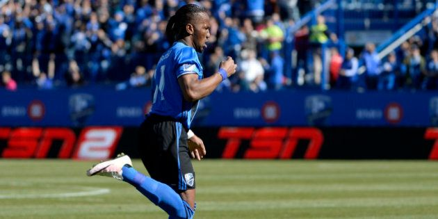 Apr 30, 2016; Montreal, Quebec, CAN; Montreal Impact forward Didier Drogba (11) reacts after scoring a goal against the Colorado Rapids during the first half at Stade Saputo. Mandatory Credit: Eric Bolte-USA TODAY Sports