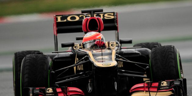 Lotus' French driver Romain Grosjean drives his Formula One car during a test session at the Montmelo...