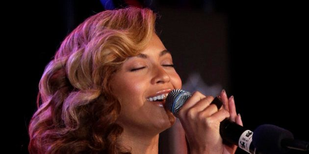 Beyoncé sings the national anthem during a news conference Thursday, Jan. 31, 2013, in New Orleans....