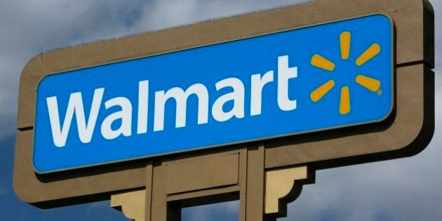 FILE - In this May 28, 2013, file photo, an outdoors sign for Walmart is seen in Duarte, Calif. After...