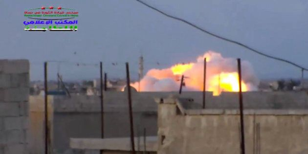 This image taken from video provided by the Syrian activist-based media group Syrian Revolutionary Command...