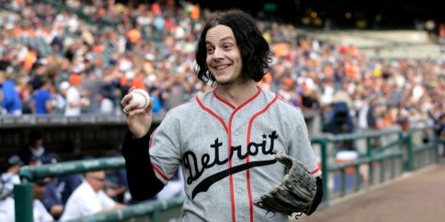 FILE - In this July 29, 2014 file photo, musician Jack White shows off a baseball before throwing out...