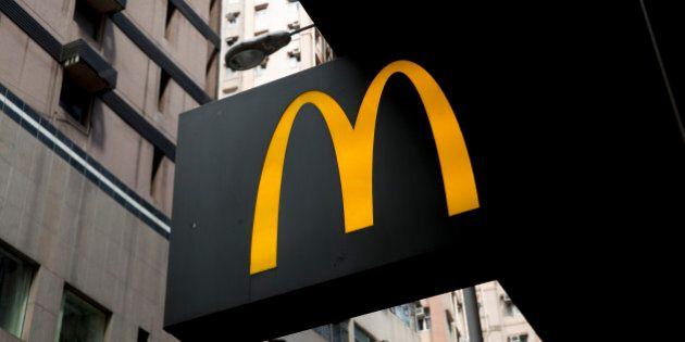 A McDonald's Corp. sign hangs outside a restaurant in Hong Kong, China, on Monday, July 28, 2014. Hong...