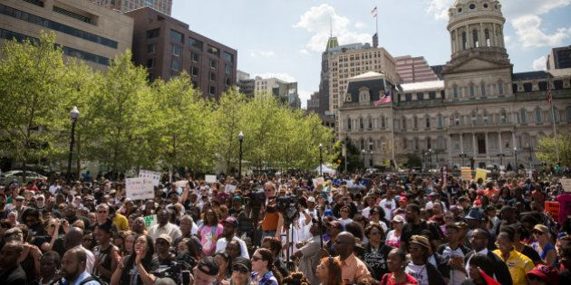 BALTIMORE, MD - MAY 03: People attend a rally lead by faith leaders in front of city hall calling for...