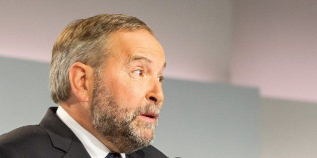 NDP leader Tom Mulcair speaks to reporters during a press conference following the first federal leaders...