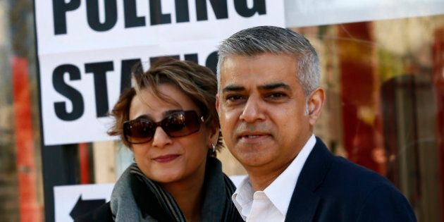 Sadiq Khan, Britain's Labour Party candidate for Mayor of London and his wife Saadiya pose for photographers...