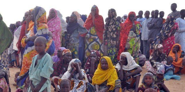 Women and children fleeing from Boko Haram attacks sit at Kabalewa Refugees Camp, Diffa in Niger Republic,...