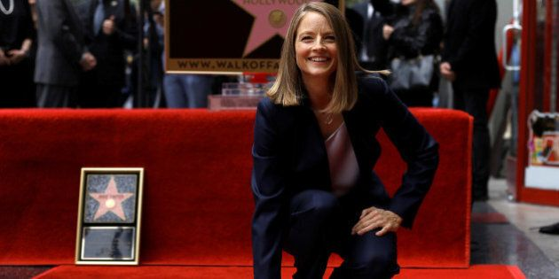 Actress Jodie Foster touches her star after it was unveiled on the Hollywood Walk of Fame in Hollywood,...