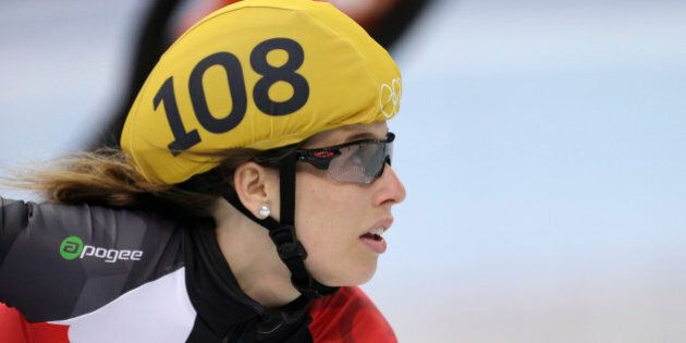 Marianne St-gelais of Canada looks at the timing board after competing in a women's 500m short track...