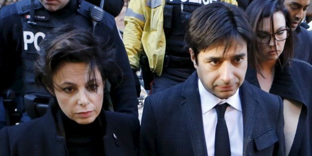 Jian Ghomeshi, a former celebrity radio host who has been charged with multiple counts of sexual assault, leaves the courthouse after the first day of his trial alongside his lawyer Marie Henein (L), in Toronto, February 1, 2016. REUTERS/Mark Blinch