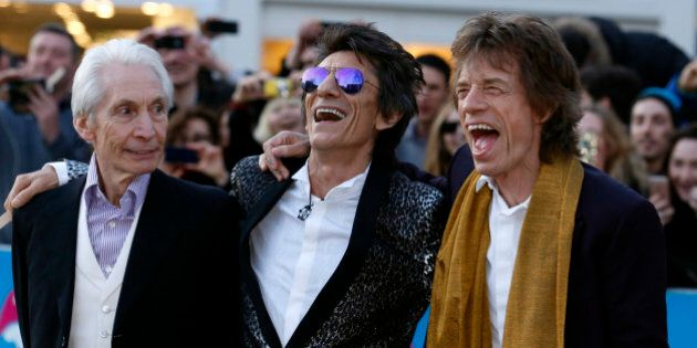 Members of the Rolling Stones (L-R) Charlie Watts, Ronnie Wood and Mick Jagger laugh as they arrive for
