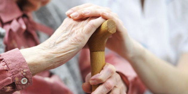 Senior woman with her caregiver at