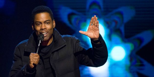 Chris Rock appears onstage at Comedy