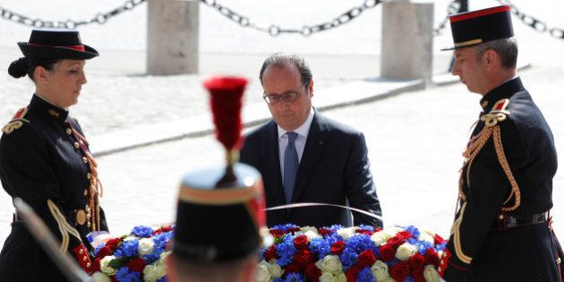 French President Francois Hollande lays a wreath during a ceremony to mark the end of World War Two in...
