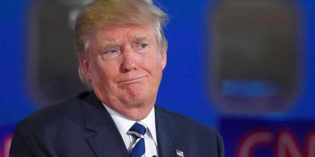 Republican presidential candidate, businessman Donald Trump reacts during the CNN Republican presidential...