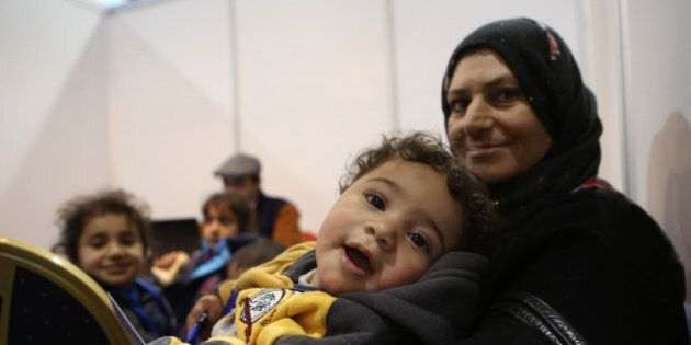 Syrian refugees wait at Marka Airport in Amman, Jordan, on Tuesday, Dec. 8, 2015 to complete their migration...
