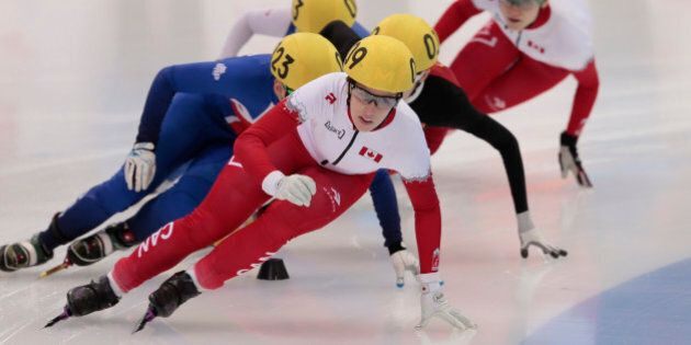 Marianne St-Gelais, of Canada, leads the field to win the women's 1500m short track final B at the Krylatskoye skating center during the short track world championships, in Moscow, Russia, on Saturday, March 14, 2015. (AP Photo/Ivan Sekretarev)