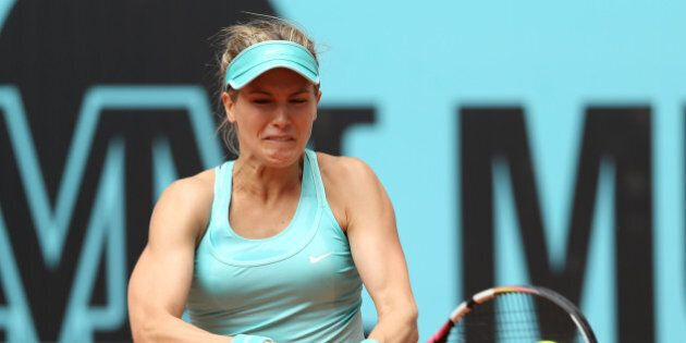 MADRID, SPAIN - MAY 03: Eugenie Bouchard of Canada plays a backhand against Barbora Strycova of the Czech...