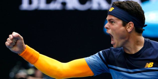 Milos Raonic of Canada celebrates after defeating Stan Wawrinka of Switzerland during their fourth round...