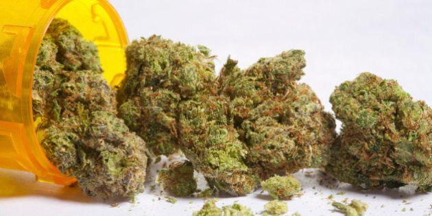 Marijuana buds coming out of pill