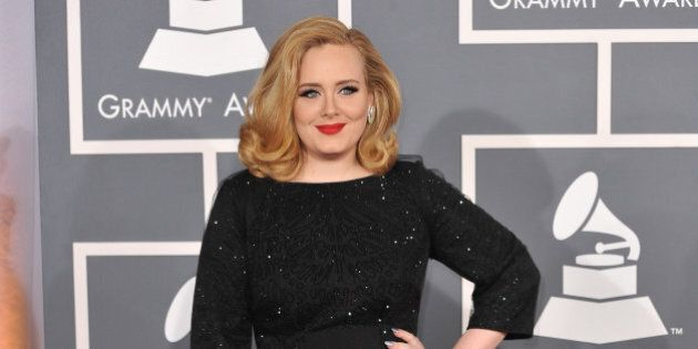 adele at the 54th annual grammy