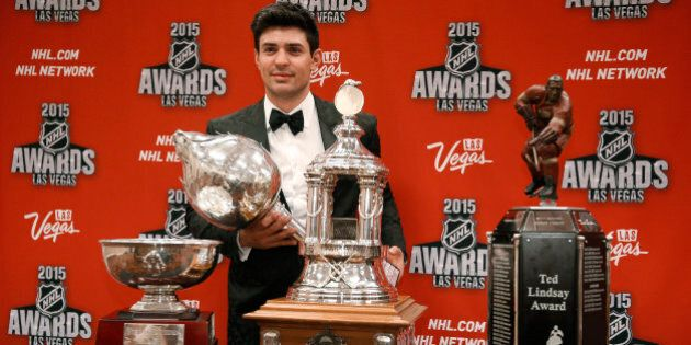 Montreal Candiens' Carey Price poses with trophies for awards he won at the NHL Awards show Wednesday,...