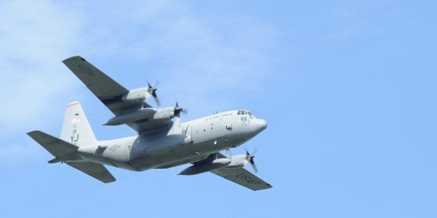 TOKYO, JAPAN - SEPTEMBER 20 : US C-130 Hercile is seen flying over Yokota Air Base in Tokyo, Japan, on...