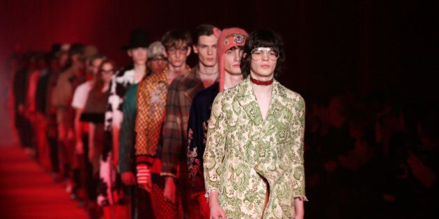 Models wear creations for Gucci men's Fall-Winter 2016-2017 collection, part of the Milan Fashion Week,...