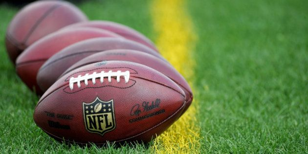 NFL footballs rest on the sideline during the New Orleans Saints NFL football training camp in White...