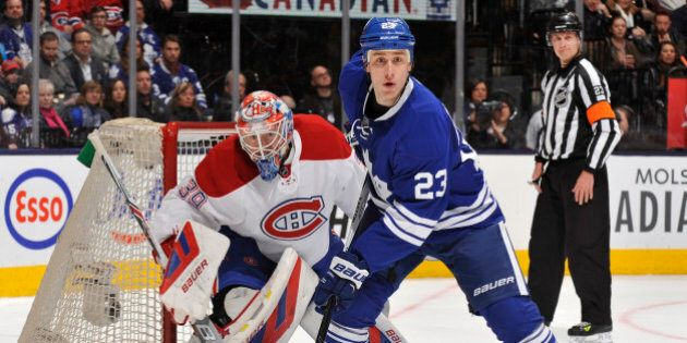 TORONTO, ON - JANUARY 23: Shawn Matthias #23 of the Toronto Maple Leafs skates in front of goalie Mike...