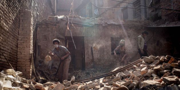 KATHMANDU, NEPAL - MAY 01: Residents work to clear rubble from a house in Bhaktapur on May 1, 2015 in...