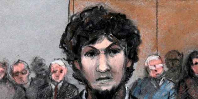 In this courtroom sketch, Boston Marathon bomber Dzhokhar Tsarnaev stands as a death by lethal injection...