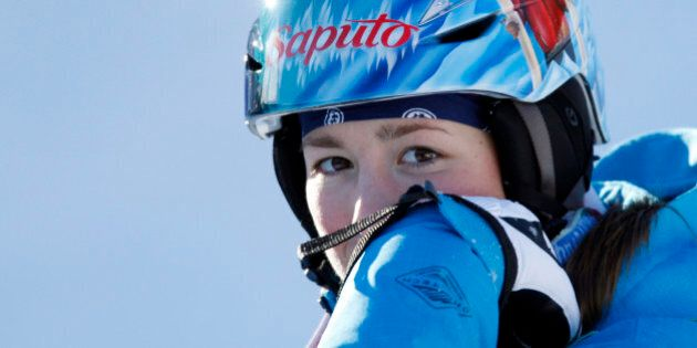 Canada's Chloe Dufour-Lapointe waits to hear her score in the ladies' moguls final at the World Cup freestyle skiing event in Wilmington, N.Y., on Thursday, Jan. 21, 2010.   (AP Photo/Mike Groll)