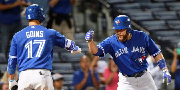 Toronto Blue Jays' Russell Martin (55) celebrates with Ryan Goins (17) after hitting a two-run home run...