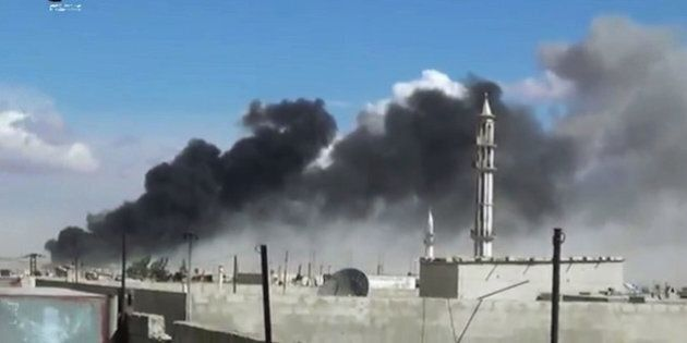 In this image made from video provided by Homs Media Centre, which has been verified and is consistent...