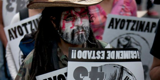 People take part in a peaceful march to mark the nine-month anniversary of the disappearance of 43 missing...